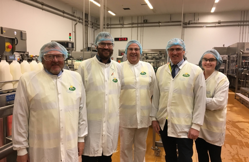 David alongside Oliver Mundell and staff at the Arla factory