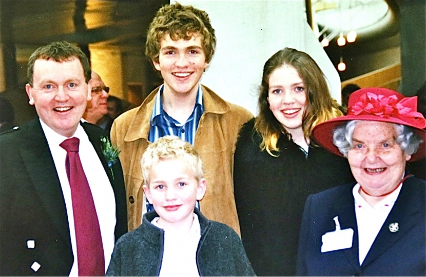 members of the Mundell family at the royal opening of the current Holyrood building in 2004.  Back, left to right: David, son Oliver (now MSP), daughter Eve and Dorah (David's mother). Front: son Lewis