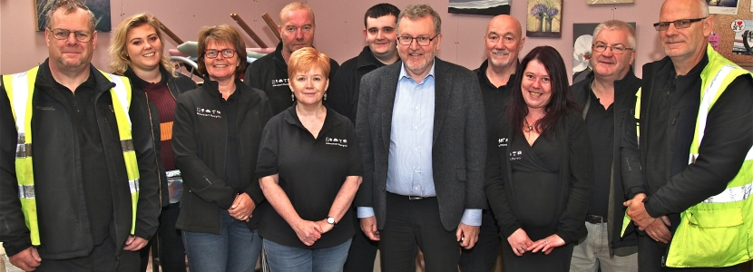 Local MP and Scottish Secretary David Mundell, seventh from left, meets staff and volunteers at Newstart Recycle's new premises in Annan.