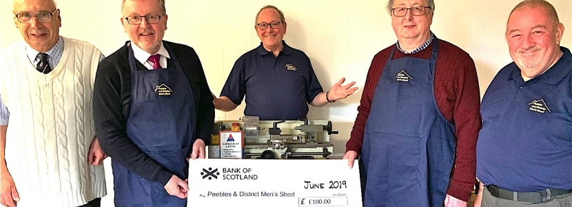 SHED BOOST . . . Tweeddale MP David Mundell, second from left, presents a cheque to Peebles and District Men's Shed team members, left to right: Tony Butcher, Les Silk, Iain Coates and Malcolm Bruce